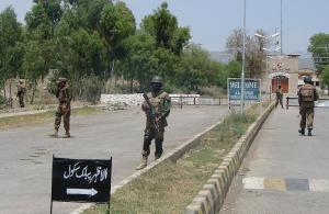 Pakistani soldiers stand guard near a public school…