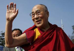 Tibetan spiritual leader the Dalai Lama waves to devotees outside the United Nations in Geneva
