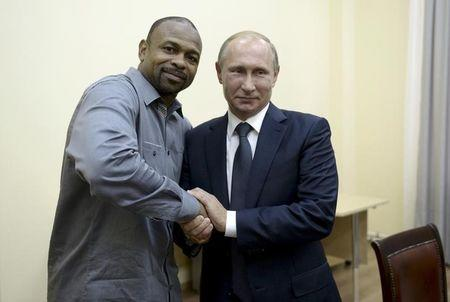 Russian President Vladimir Putin meets with U.S. boxer Roy Jones, Jr. in Sevastopol