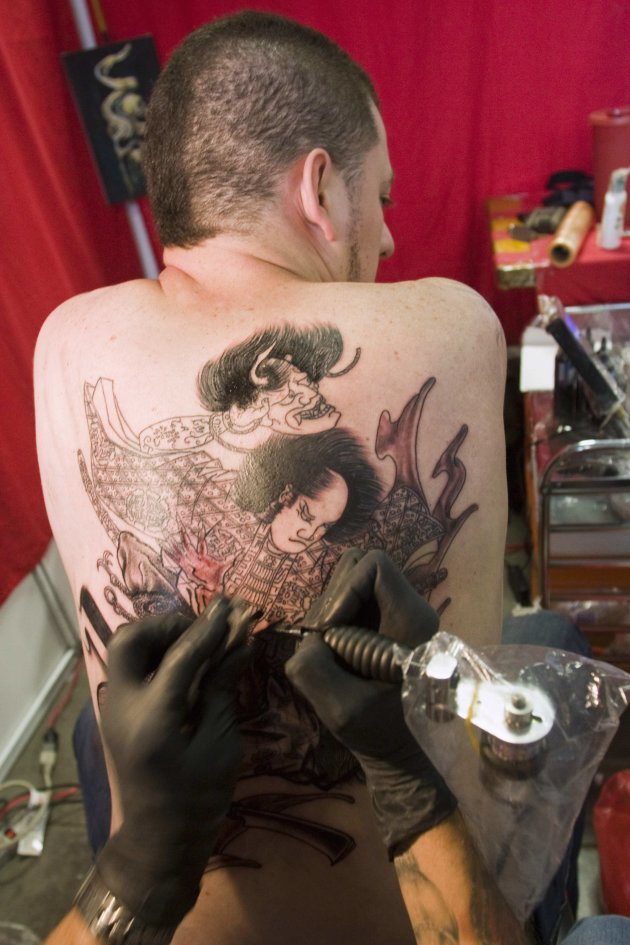 A man gets a tattoo during the 2nd Annual Tattoo Expo in Medellin