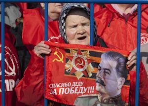 An elderly Russian Communist party supporter holds …