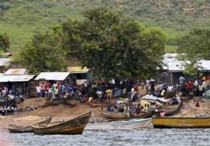 A general view shows the landing site where retrieved bodies are gathered after a boat carrying mostly Congolese refugees capsized at the shores of Lake Albert during rescue operations by the Uganda Marine Unit in Ntoroko