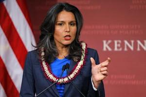 U.S. Representative Gabbard speaks after being awarded a Frontier Award during a ceremony at Kennedy School of Government at Harvard University in Cambridge
