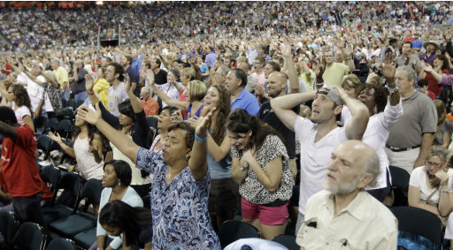 Worshipers pray during The Response, a call to prayer for a nation in crisis, Saturday, Aug. 6, 2011, in Houston. Texas Gov. Rick Perry attended the daylong prayer rally despite criticism that the event inappropriately mixes religion and politics. (AP Photo/David J. Phillip)
