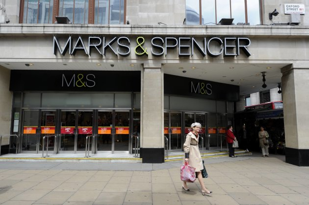 REFILE - CORRECTING YEAR TO 2012<br /><br /><br /><br /> A woman walks out of the Marble Arch  branch of Marks and Spencer in central London June 8, 2012.  British retailer Marks & Spencer Plc plans to launch an in-store banking service next month, backed by HSBC, providing fresh competition to the UK's established but deeply unpopular high street banks.  The group, which serves around 21 million customers each week, said 50 M&S Bank branches would open in M&S stores across the UK over the next two years, with the first branch scheduled to open in July at its flagship Marble Arch store in London.  REUTERS/Paul Hackett  (BRITAIN - Tags: BUSINESS)