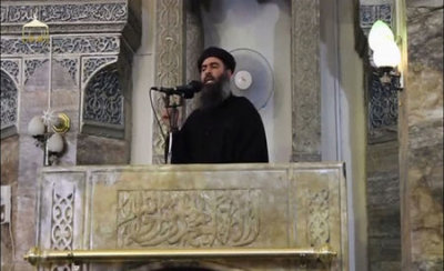 A man purported to be the reclusive leader of the militant Islamic State Abu Bakr al-Baghdadi from a video recording posted on the Internet on July 5, 2014, (REUTERS/Social Media Website via Reuters TV/Files)