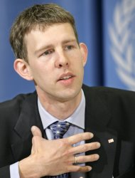 "FILE - Maarten van Aalst, leading climate specialist for the Red Cross and Red Crescent, speaks about how climate change will affect people and assets during the presentation of the Intergovernmental Panel on Climate Change (IPCC) report at a press conference at the European headquarters of the United Nations in Geneva, Switzerland, in this April 11, 2007 file photo. Top international climate scientists and disaster experts meeting in Africa had a sharp message Friday Nov. 18, 2011 for the world's political leaders: Get ready for more dangerous and ""unprecedented extreme weather"" caused by global warming. (AP Photo/Keystone, Salvatore Di Nolfi, File)"