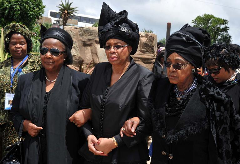 The widow of Nelson Mandela, Graca Machel (C), and his x-wife Winnie Mandela Madikizela (R), arrive for South African former president Nelson Mandela's funeral ceremony in Qunu on December 15, 2013
