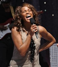 FILE - In this Sept. 1, 2009 file photo, singer Whitney Houston performs on 'Good Morning America' in New York's Central Park. Houston, who reigned as pop music's queen until her majestic voice and regal image were ravaged by drug use, has died, Saturday, Feb. 11, 2012. She was 48.(AP Photo/Evan Agostini, File)