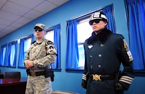 US (L) and South Korean (R) soldiers stand guard inside…