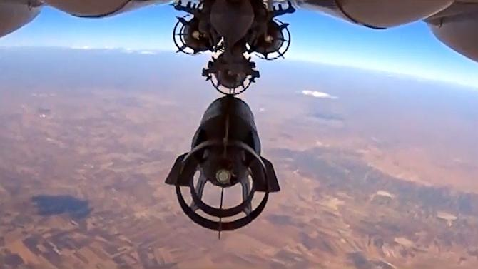 A bomb is dropped from a Russian Su-24M bomber during an airstrike in Syria in this image taken from video on the Russian Defence Ministry's website on October 5, 2015