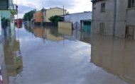 A flooded street is pictured in San Gavino Monreale on Sardina island November 18, 2013. REUTERS/Rosaspress