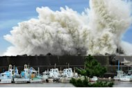 Surging waves hit against the breakwater in Udono in a port town of Kiho, Mie Prefecture, central Japan, Wednesday, Sept. 21, 2011. A powerful typhoon was bearing down on Japan's tsunami-ravaged northeastern coast Wednesday, approaching a nuclear power plant crippled in that disaster and prompting calls for the evacuation of more than a million people. (AP Photo/Chunichi Shimbun, Daiji Yanagida) JAPAN OUT, MANDATORY CREDIT, NO SALES