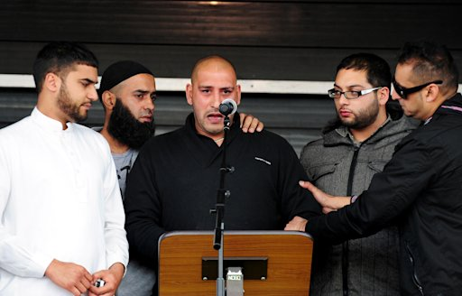 Shazad Ali and Abdul Musavir's brother Abdul Qudoos, center, is supported by friends as he speaks at a peace rally a peace rally in Summerfield Park, Birmingham, England Sunday Aug. 14, 2011. Community groups held a peace rally Sunday in England's second-largest city against the hit-and-run attack that claimed three lives during rioting in Birmingham. Scores of people gathered in Winson Green, where three Muslim men _ Haroon Jahan, 20, and brothers Shazad Ali, 30, and Abdul Musavir, 31 _ were mowed down and mortally wounded Wednesday when a car struck them at high speed. The trio had been with a larger group guarding a row of Pakistani-owned shops from looters.  (AP Photo/Rui Vieira/PA Wire)   UNITED KINGDOM OUT