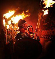 Members of the Jarl Squad dressed in Viking costumes in Lerwick, on the Shetland Isles, off the north-east coast of Scotland, during the Up Helly Aa Viking festival on Tuesday Jan. 31, 2012. Hundreds of costumed guizers carrying torches took to the streets of a Scottish island during the annual Up Helly Aa festival. Originating in the 1880s, the tradition which celebrates Shetland's Norse heritage, sees around 900 guizers drag a Viking galley through the streets of Lerwick, led by a horde of 'Vikings'. The festival, that attracts thousands of revelers each year , culminates in the burning of the Viking galley. (AP Photo / Danny Lawson/PA) UNITED KINGDOM OUT NO SALES NO ARCHIVE