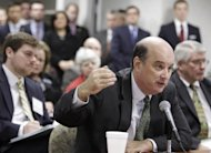 FILE - In this Nov. 15, 2010, file photo Social Security Commissioner Michael Astrue responds to questions at a hearing in Akron, Ohio. A Senate oversight committee told Astrue the agency hasn't done enough to trim its disability claims backlog. Applications are up nearly 50 percent over a decade ago as people with disabilities lose their jobs and can't find new ones in an economy that has shed nearly 7 million jobs. Many wait two years or more before their cases are resolved. (AP Photo/Tony Dejak, File)