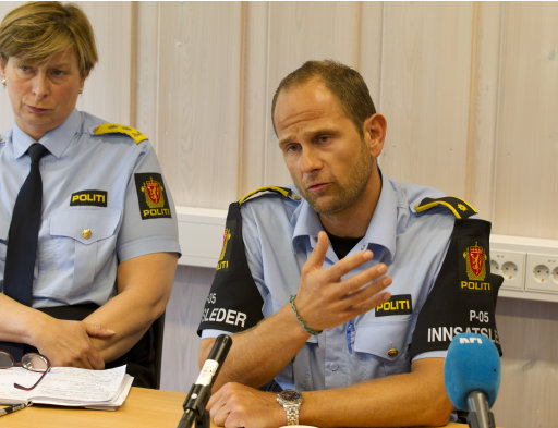 Police officer Haavard Gaasbakk, right   and chief of police Sissel Hammer during a press briefing in Hoenefoss, Norway  Wednesday July 27 2011. Police have come under close scrutiny over how long it took them to reach the island after first reports of shots being fired at the island youth camp Friday. Although the island is only about 25 miles (40 kilometers) from the Norwegian capital, police needed 90 minutes to get to the scene. Squad leader  Gaasbakk told reporters that  the shooter, Anders Behring Breivik,  lay down his weapon and held his hands high over his head when approached by his team. (AP Photo /Terje Bendiksby, Scanpix)  NORWAY OUT