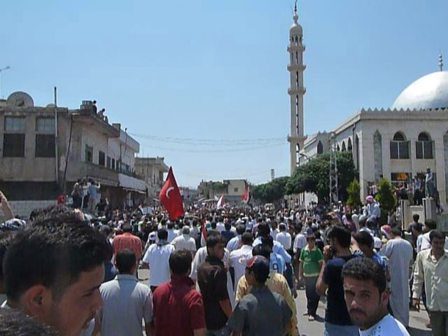 Demonstrators protesting against Syria's President Bashar al-Assad gather in Hula