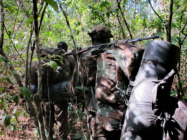 In this photo of  Thursday April 19, 2012 Ugandan soldiers hunting for Joseph Kony walk through the jungle near River Vovodo, Central African Republic . For Ugandan soldiers tasked with catching Josep