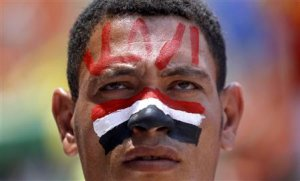 A protester opposing Egyptian President Mohamed Mursi …