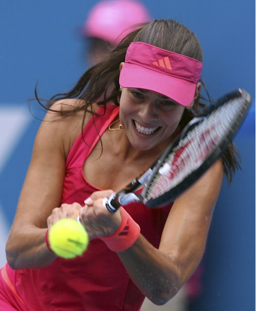Ana Ivanovic of Serbia plays a backhand shot in her first round match against Lucie Safarova at the Sydney International tennis tournament in Sydney, Australia, Sunday, Jan. 8, 2012. Safarova won the match 7-6, 6-2.(AP Photo/Rob Griffith)