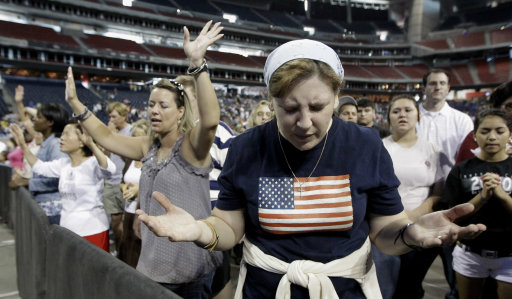 Lucy West, of Killeen, Texas, prays at The Response, a call to prayer for a nation in crisis, Saturday, Aug. 6, 2011, in Houston. Texas Gov. Rick Perry is scheduled to attend the daylong prayer rally despite criticism that the event inappropriately mixes religion and politics. (AP Photo/David J. Phillip)