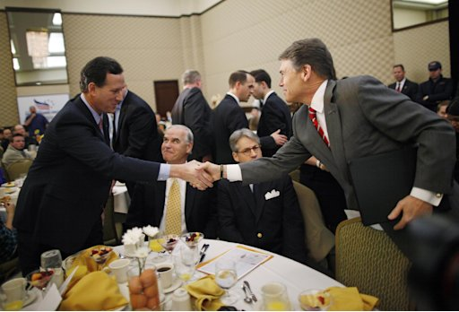 Republican presidential candidates, former Sen. Rick Santorum, R-Pa., left, and Texas Gov. Rick Perry, right, greet each other as they campaign at the Faith and Freedom Coalition Prayer Breakfast in Myrtle Beach, S.C., Sunday, Jan. 15, 2012. (AP Photo/Charles Dharapak)