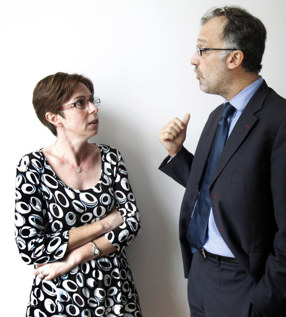Catherine Tissier talks to her lawyer Rodolphe Bosselut in Paris Wednesday Sept. 21, 2011. Tissier a former follower of the  conservative Catholic movement Opus Dei is to take the the religious moveme
