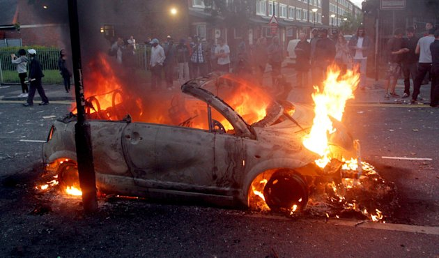 A car is seen on fire in Hackney, east London, as rioters were rampaging across London, Monday, Aug. 8, 2011. Violence and looting spread across some of London's most impoverished neighborhoods on Monday, with youths setting fire to shops and vehicles, during a third day of rioting in the city that will host next summer's Olympic Games. (AP Photo/PA, Lewis Whyld) UNITED KINGDOM OUT, NO SALES, NO ARCHIVE