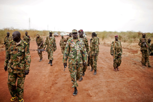 Sudan People's Liberation Army (SPLA) forces at the frontline in Tachuien, Unity State, South Sudan on Friday, May 11, 2012. In late April,<br /><br /><br /><br /><br /><br /><br /><br /><br />  tensions between Sudan and South Sudan erupted into armed conflict along their poorly defined border. Thousands of SPLA forces have been deployed to Unity State where the two armies are at a tense stalemate around the state's expansive oil fields. Fighting between the armies lulled in early May after the U.N. Security Council ordered the countries to resume negotiations. South Sudan seceded from the Republic of Sudan in July 2011 following decades of civil war. (AP Photo/Pete Muller)