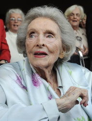 """FILE - In this May 27, 2009 file photo, Dolores Hope, the widow of legendary comedian Bob Hope, looks on as partygoers sing """"Happy Birthday"""" to her during her 100th birthday party in Los Angeles. Hope, who was married to Bob Hope for 69 years and sang at his shows, died Monday, Sept. 19, 2011 of natural causes at home in Los Angeles. She was 102. (AP Photo/Chris Pizzello, file)"""