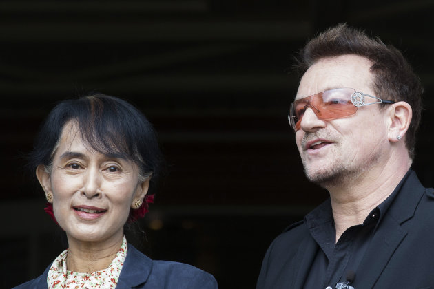 Irish singer and activist Bono and Myanmar's opposition leader Aung San Suu Kyi, left, pose for the media after attending a conference of the Oslo Forum at the Losby Gods resort, about 13 kilometers (