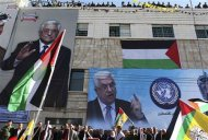 "Banners depicting Palestinian President Mahmoud Abbas cover a wall during a rally in the West Bank city of Hebron, supporting the resolution that would change the Palestinian Authority's United Nations observer status from ""entity"" to ""non-member state"" November 29, 2012. The U.N. General Assembly is set to implicitly recognize a sovereign state of Palestine on Thursday despite threats by the United States and Israel to punish the Palestinian Authority by withholding much-needed funds for the West Bank government. REUTERS/Ammar Awad"