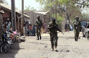 Nigerian troops patrolling in the streets of the remote…