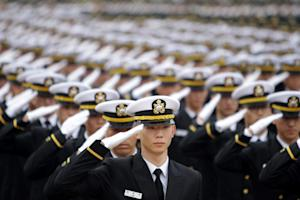 New South Korean military officers salute during a…