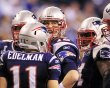 Patriots quarterback Brady looks at the clock in the huddle during the second quarter against the Giants the NFL Super Bowl XLVI football game in Indianapolis