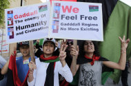 Libyan chant slogans against Moammar Gadhafi during a demonstration in the rebel-held capital Benghazi, Libya, Saturday, June 25, 2011. (AP Photo/Hassan Ammar)