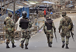 Liberian soldiers patrol the West Point area as people's movement is controlled due to fear of the Ebola virus spreading, in the city of Monrovia, Liberia, Saturday, Aug. 23, 2014. (AP Photo/Abbas Dulleh)