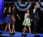 President Barack Obama waves as he walks on stage with first lady Michelle Obama and daughters Malia and Sasha at his election night party Wednesday, Nov. 7, 2012, in Chicago. President Obama ...