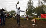 A man celebrates the victory of Barack Obama in the U.S. presidential elections in Obama's ancestral home village of Nyangoma Kogelo