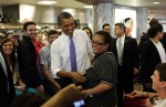 U.S. President Obama smiles during a visit to Sloopy's diner inside the student union at the Ohio State University in Cleveland