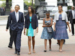 President Barack Obama, left, with first lady Michelle Obama, right, and their daughters Sasha and Malia, second from left, walk from the White House in Washington to a nearby church to attend ...