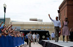 US President Barack Obama (2nd R) and First Lady Michelle Obama (R) arrive to deliver remarks during a campaign event