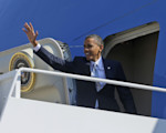 President Barack Obama waves as he boards Air Force One before his departure from Andrews Air Force Base, Sunday, Sept., 30, 2012. Obama is traveling to Las Vegas for a campaign rally then will be ...