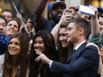 "Actor Zac Efron greets fans as he arrives for the gala presentation of ""The Paperboy"" at the 37th Toronto International Film Festival"