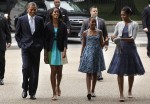 U.S. President Obama, first lady Michelle and their daughters walk out from White House to attend Sunday service in Washington