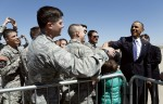 Obama greets military personnel upon his arrival at Buckely Air Base in Denver