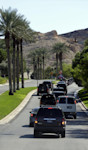 Motorcade vehicles for President Barack Obama, are seen leaving the Lake Las Vegas resort enroute to a local campaign office, Monday, Oct. 1, 2012 in Henderson, Nev. Sometimes all President Barack ...