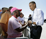 President Barack Obama greets supporters on the tarmac upon his arrival at McCarran International airport, Sunday, Sept. 30, 2012 in Las Vegas. Obama traveled to Las Vegas for a campaign rally then ...