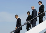 President Barack Obama, followed by, from second from left, Rep. Rosa DeLauro, D-Conn., Rep. John Larson, D-Conn., and Sen. Chris Murphy, D-Conn., walks down the steps of Air Force One at Bradley ...